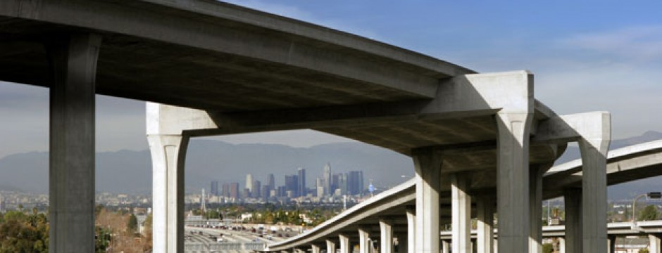 Elevated highway structure with cityscape in background